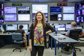 Livingston, LA - 10/9/2015 - Gabriela Gonzalez stands in the control room at the LIGO observatory in Louisiana.  The LIGO Scientific Collaboration (LSC) is a group of scientists seeking to make the first direct detection of gravitational waves, use them to explore the fundamental physics of gravity, and develop the emerging field of gravitational wave science as a tool of astronomical discovery. The LSC works toward this goal through research on, and development of techniques for, gravitational wave detection; and the development, commissioning and exploitation of gravitational wave detectors.   The Laser Interferometer Gravitational-Wave Observatory (LIGO) consists of two widely separated installations within the United States -- one in Hanford, Washington and the other in Livingston, Louisiana -- operated in unison as a single observatory. LIGO is operated by the LIGO Laboratory, a consortium of the California Institute of Technology (Caltech) and the Massachusetts Institute of Technology (MIT). Funded by the National Science Foundation, LIGO is an international resource for both physics and astrophysics.