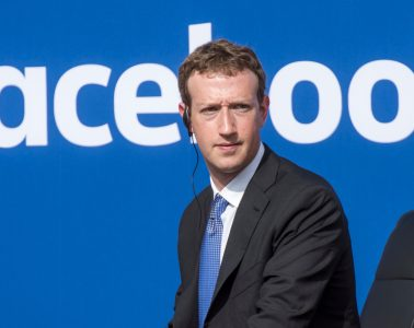 "Mark Zuckerberg, chief executive officer of Facebook Inc., listens as Narendra Modi, India's prime minister, not pictured, speaks during a town hall meeting at Facebook headquarters in Menlo Park, California, U.S., on Sunday, Sept. 27, 2015. Prime Minister Modi plans on connecting 600,000 villages across India using fiber optic cable as part of his ""dream"" to expand the world's largest democracy's economy to $20 trillion. Photographer: David Paul Morris/Bloomberg *** Local Caption *** Mark Zuckerberg"