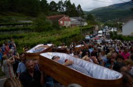 SANTA MARTA DE RIBARTEME, SPAIN. 29TH JULY 2017. Pilar Domínguez Muñoz  inside her coffin during the funeral march of Santa Marta de Ribarteme,  where devotees enact their own death after surviving a serious accident or illness, while others are thanking the saint for saving a relative.The funeral march, which dates to medieval times, is an example of both pagan and religious fervor in Galicia, the northwestern region of Spain where legends abound about the healing powers of local witches, or meigas. Healing - both physical and spiritual - is also at the heart of some of the world's main Catholic pilgrimages, like Lourdes in France and Fatima in Portugal. ( Photo Samuel Aranda for The New York Times)                              NYTCREDIT: Samuel Aranda for The New York Times